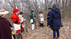 Students re-enact the Revolutionary War.