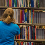 student in Bracken Library