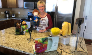 Counselor uses puppets to connect to students