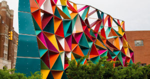 a colorful statue constructed of triangles connected together