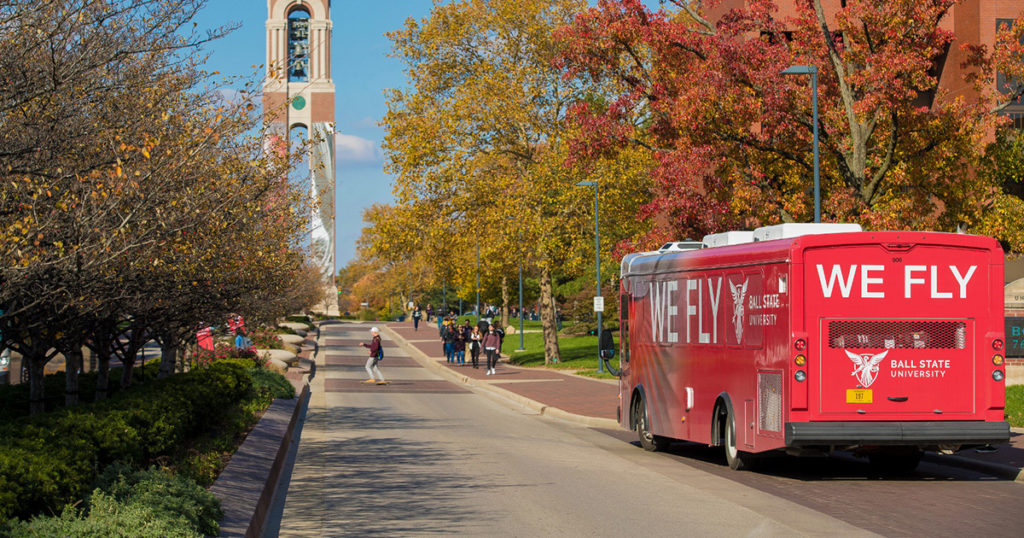 A Ball State shuttle bus stops to pick up students.