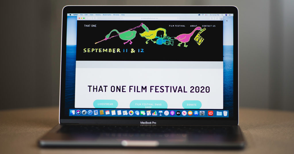"A laptop is showing a homescreen for ""That One Film Festival 2020"""