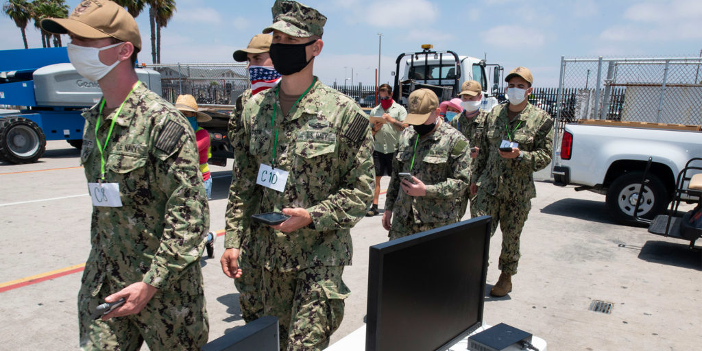 Troops with face masks.