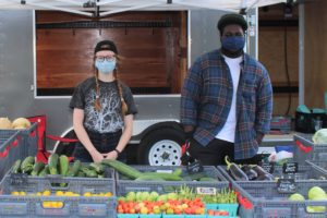 Photo of Ball State students at a produce table