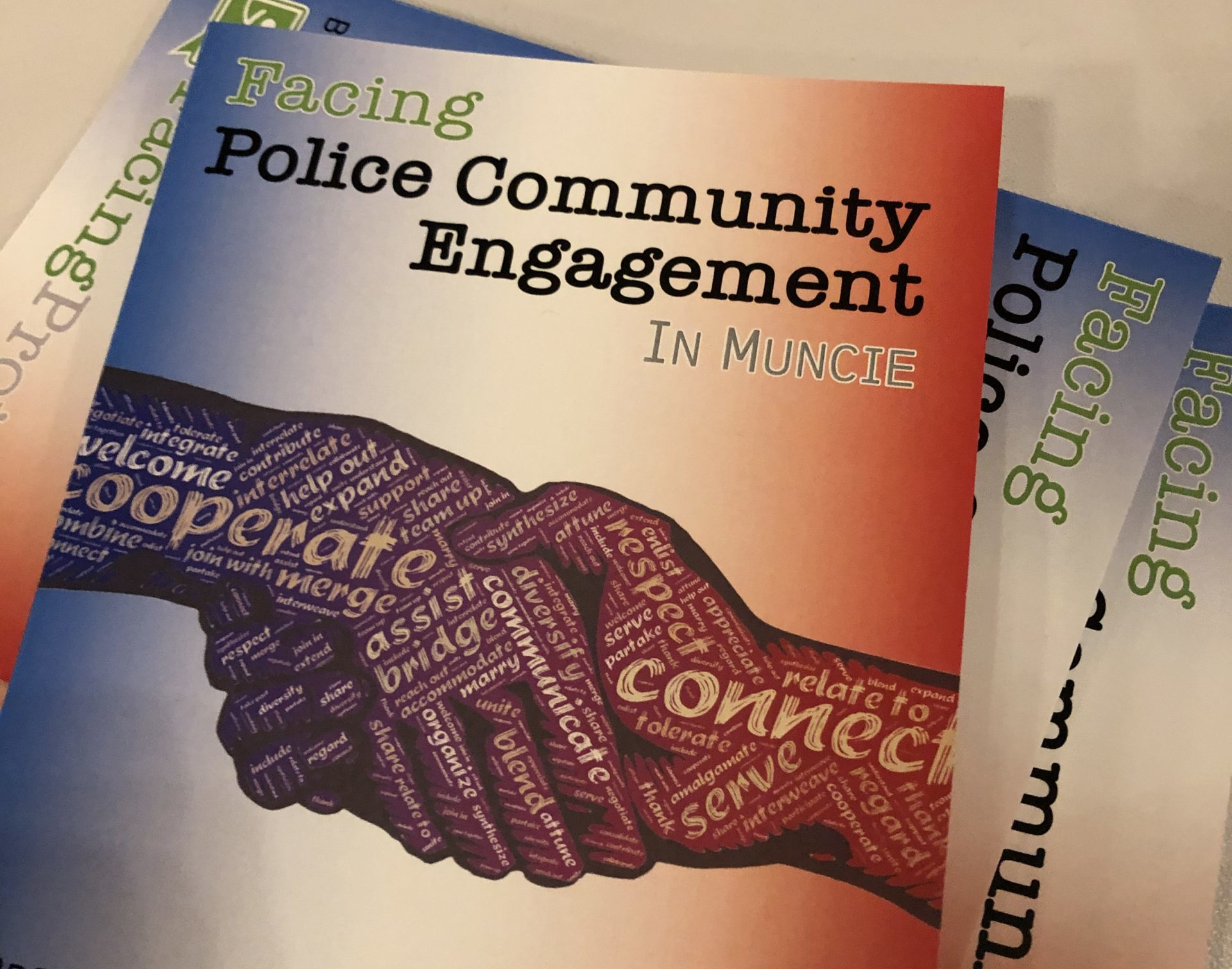 Photo of a booklet for the Facing Police Community Engagement Event in Muncie, Indiana