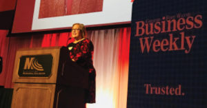 Tiffanney Drummond speaking at a podium