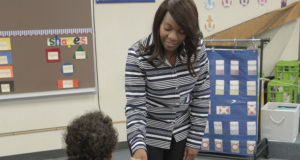 Ty talking with a young student