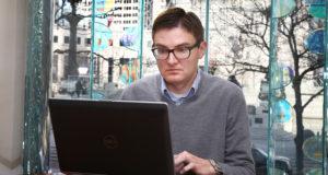 Matt looking at a laptop screen