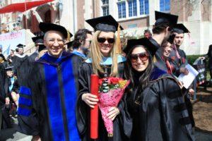 Rachel Geesa with Dr. William Sharp and Dr. Serena Salloum, all wearing academic regalia