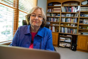 Ann Leitze seated in office