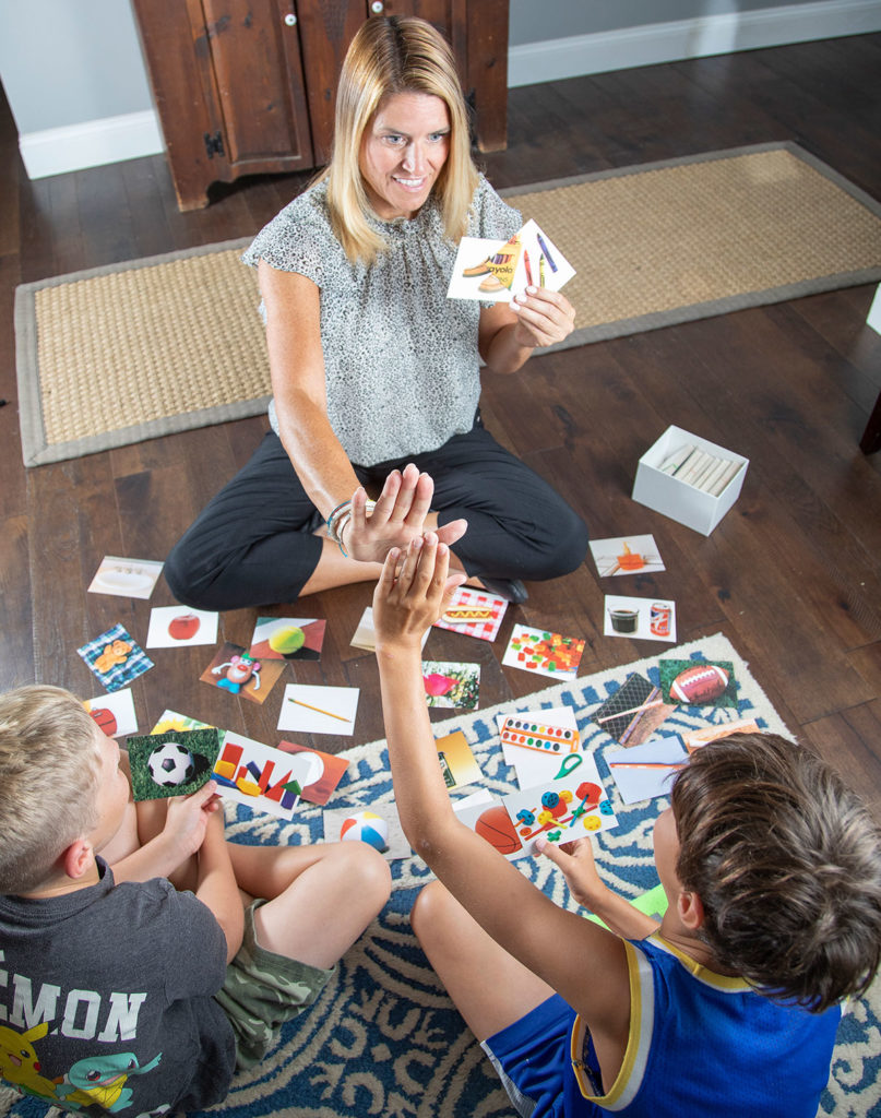 Angela Bricker with two children, looking at photos together