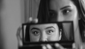 Still from La Leyenda Negra of Aleteia's reflection (Monica Betancourt) and Rosarito out of focus (Kailei Lopez)