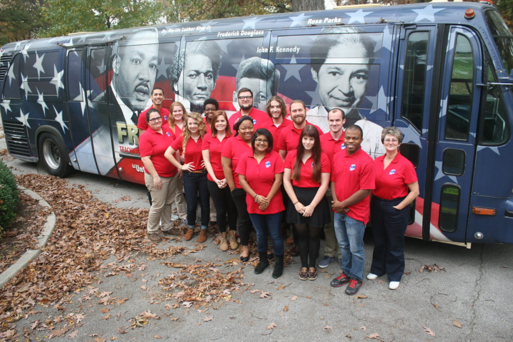 Group standing in front of freedom bus