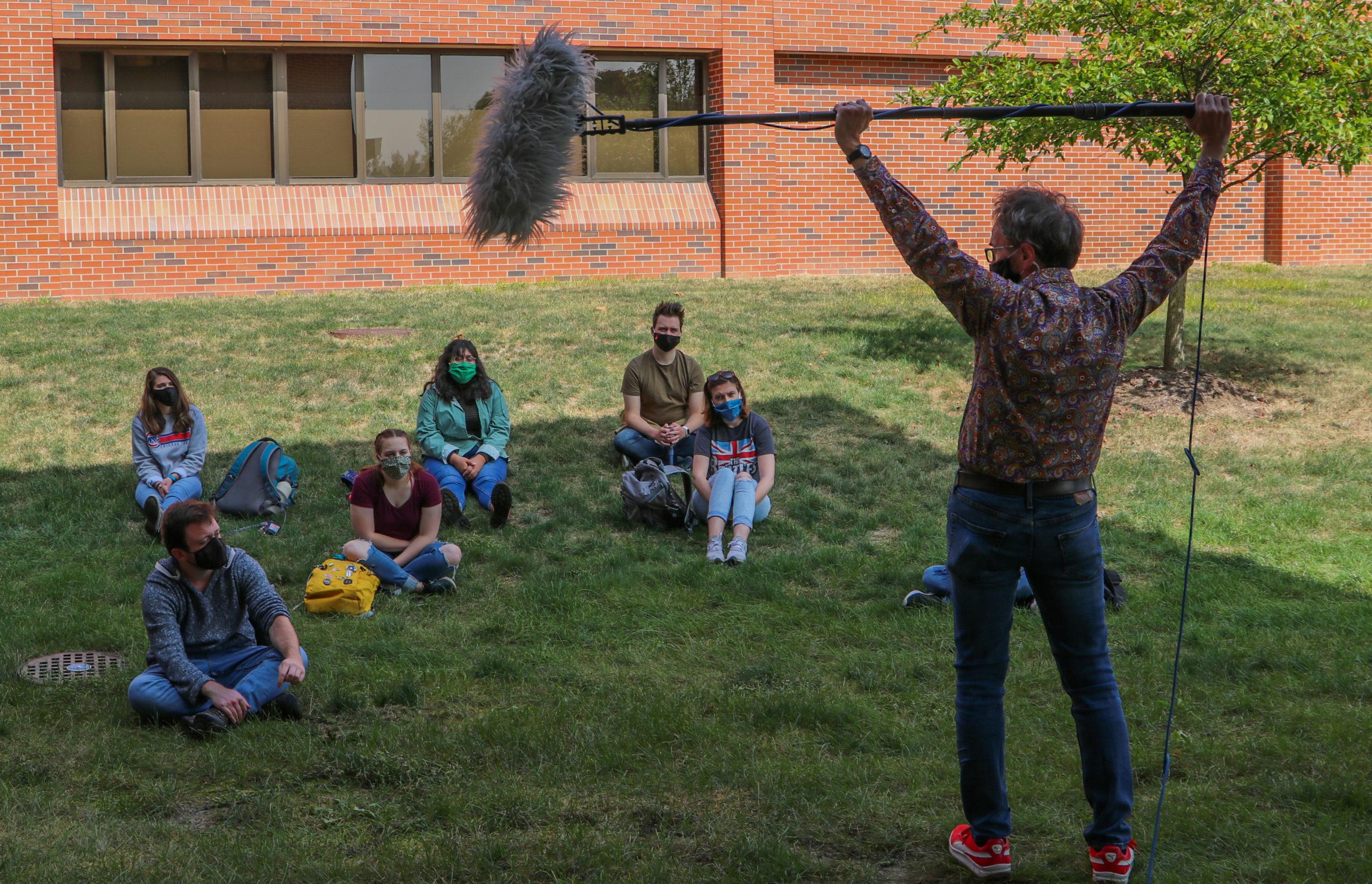 Stan teaches his audio class outdoors.