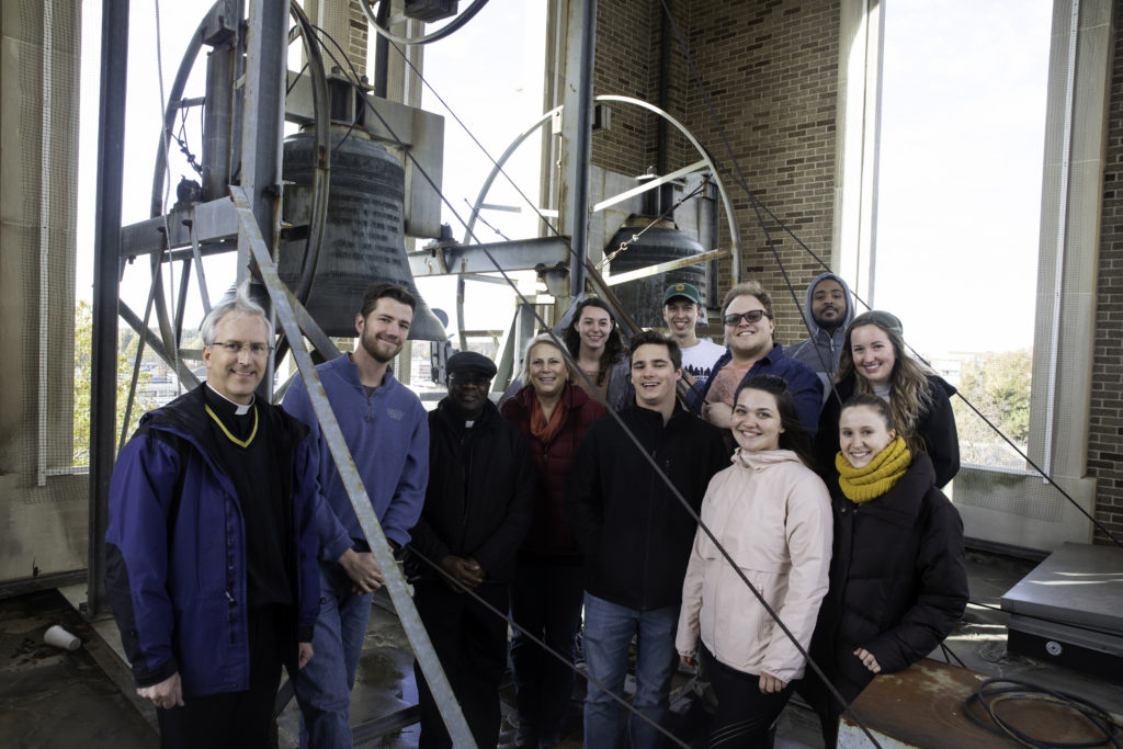 Group of students posing at the top of the bell tower of St. Mary Church in Muncie