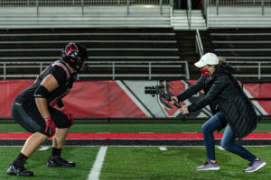 Faith filming during the Ball State Football intro video shoot.