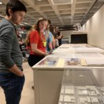 Students Jacob Chavez and Abbie Bates become acquainted with the building plans available in the Columbus Indiana Architectural Archives.